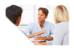 people meeting at desk