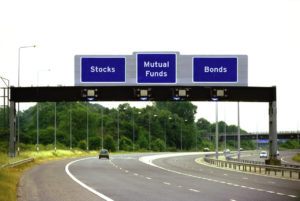 Three Overhead Road Sign Saying Stocks Mutual Funds and Bonds