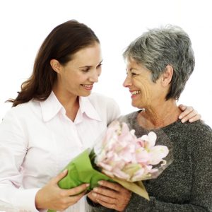 Mother and Daughter Holding a Bouquet of Flowers --- Image by © Royalty-Free/Corbis